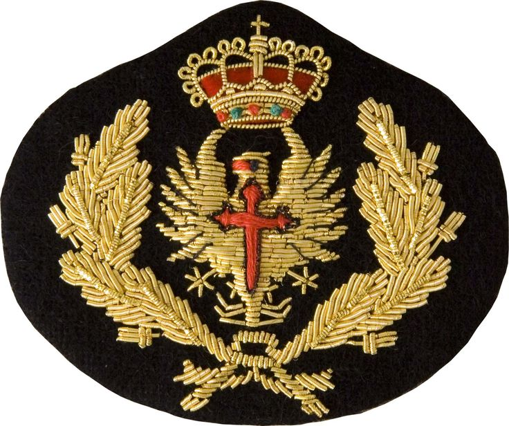 Spanish Navy officer's badge is hand embroidered with gold bullion and silk threads while velvet is used in the crown