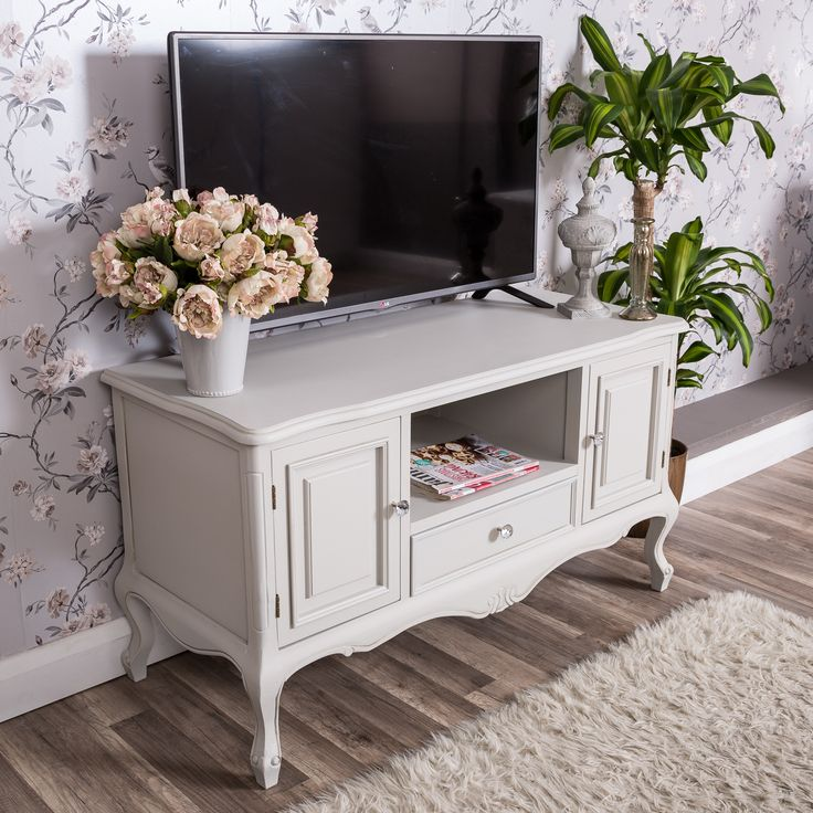 A stunning traditional style grey television stand with pretty curved legs and crystal effect handles.