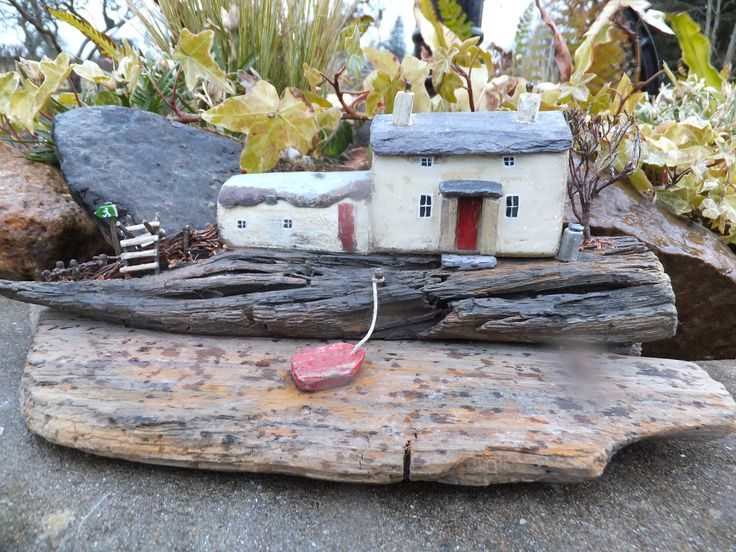 """""""Holiday Cottage on the Pembrokeshire Coastal Footpath"""".  Handmade in Wales and set on driftwood from Pendine Beach in West Wales.  Using reclaimed materials, Welsh Slate and dried heather from Brecon Beacons"""