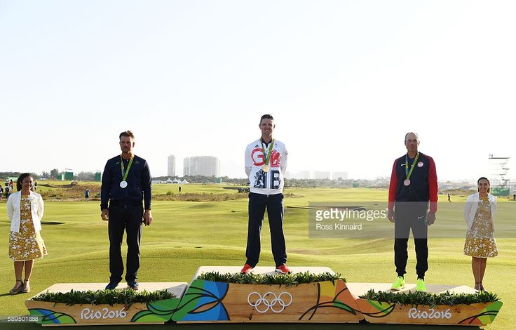 Justin Rose (C) of Great Britain celebrates with the gold medal, Henrik Stenson…