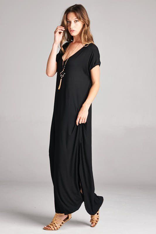 Comfort and versatility await in this ultra-soft Black maxi dress. Short-sleeved with v-neck. Oversized fit with two side slits. Great for lounging or add sandals or wedges for a day out. If in-betwee