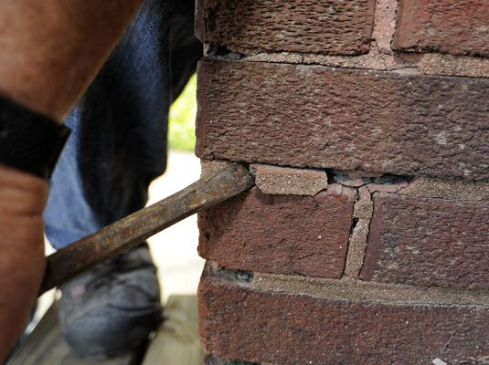 Patching mortar on brick walls keeps moisture from getting behind the brick. Knowing how to patch mortar on brick walls can help you to repair the damage to your walls and prevent further structural damage. To replace the mortar, you'll need a chisel with a narrow blade, a stiff brush, mortar mix, a trowel or …