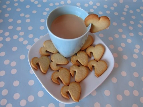 heart cookies hanging on a coffee cup (or milk)!!