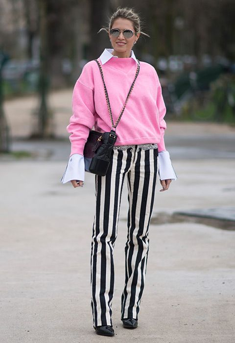Who? Brazilian blogger Helena Bordon. Where? Paris Fashion Week. Wearing? Seriously cool striped trousers, teamed with a crisp shirt and contrasting pink jumper. Follow suit and soften your bold-as bottom half by reaching for some candyfloss sweetness, preferably in the form of an off-duty sweat. You = the coolest