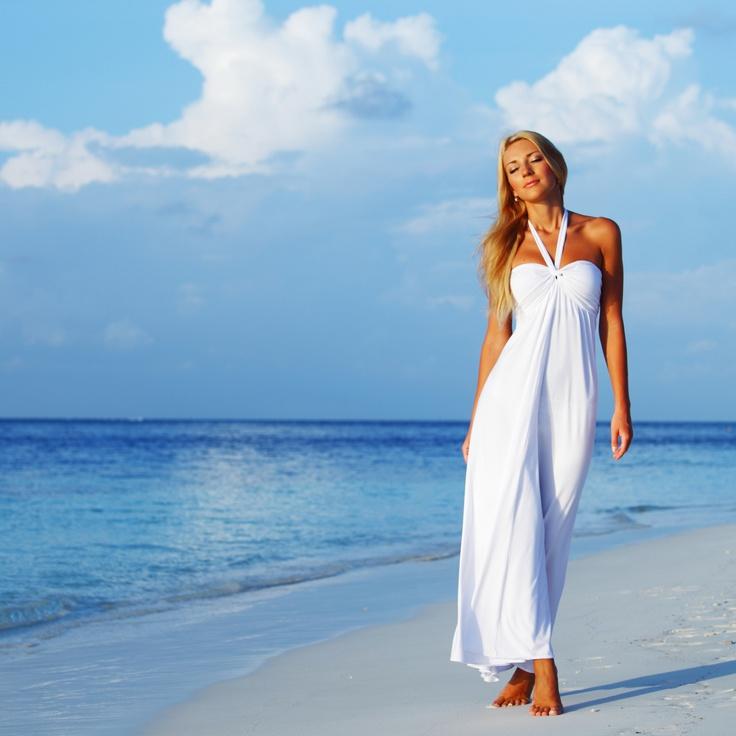Hot girl posing on a beach.