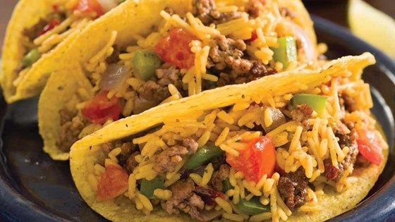 These beef tacos with bell peppers, onion, and Mexican rice are quick and easy--just what you need after a busy day.