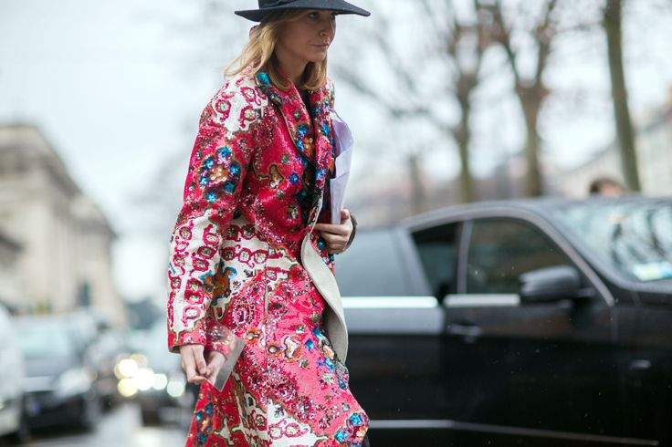 MFW: An ornate, colorful, sequined coat on the streets on Milan