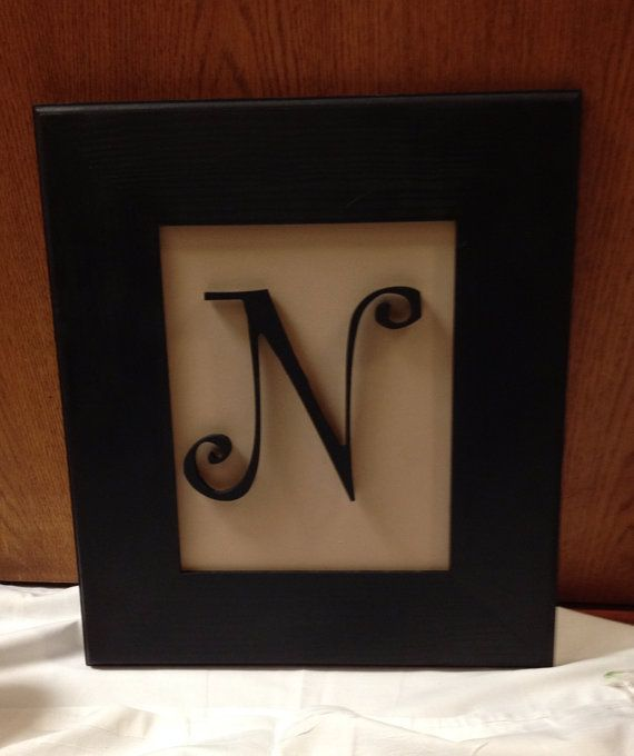 Framed initial wall decor on Etsy, $18.99
