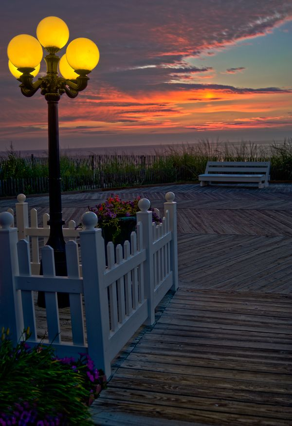 Hints of oranges, yellows & purple combine. The lamp post adds to the ambiance. This is a real sweet Rehoboth Beach Sunset.