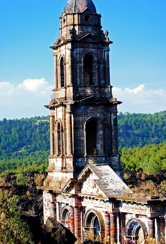 The abandoned church of San Juan Parangaricutiro, Michoacán, Mexico - vacant since 194, all that remains from a town that was covered in lava from the emerging volcano Paricutin over a period of eight years,