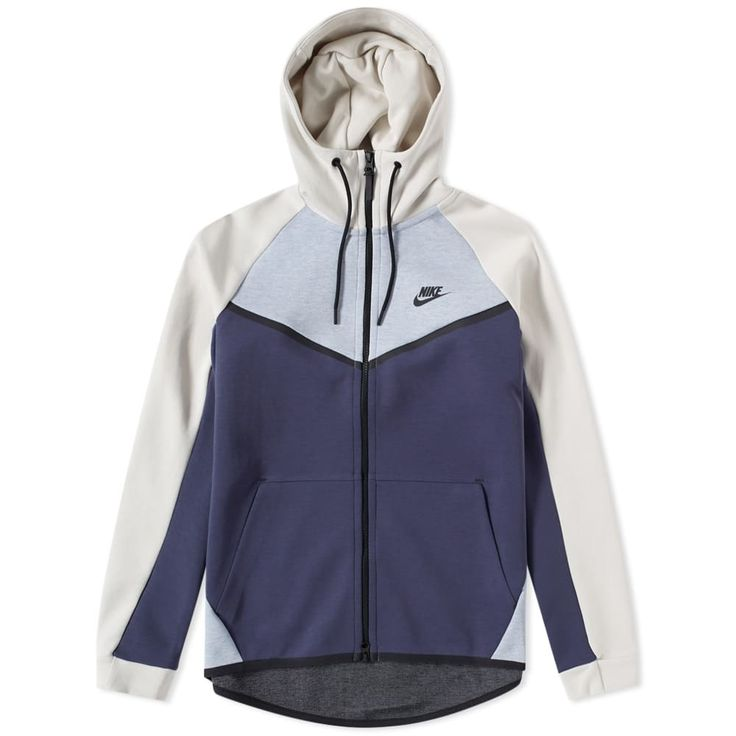 Inspired by the original Nike running jacket, this Windrunner hoody takes cues from the sporting icon with its chevron panelled design and technical construction. Built from Nike's Tech Fleece, the Windrunner sees lightweight warmth and comfort for life on-the-go, while raglan sleeves assist with movement; creating a versatile hoody boasting style and substance. Providing extra coverage and security, the running jacket is fitted with an adjustable hood and dropped back hem, all finished off…
