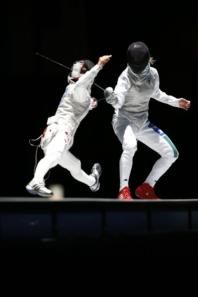 Valentina Vezzali defends against Nam Hyun-hee and adds a bronze to her collection of eight Olympic fencing medals. Vezzali's success helps Italy sweep the podium in the women's foil individual competition.