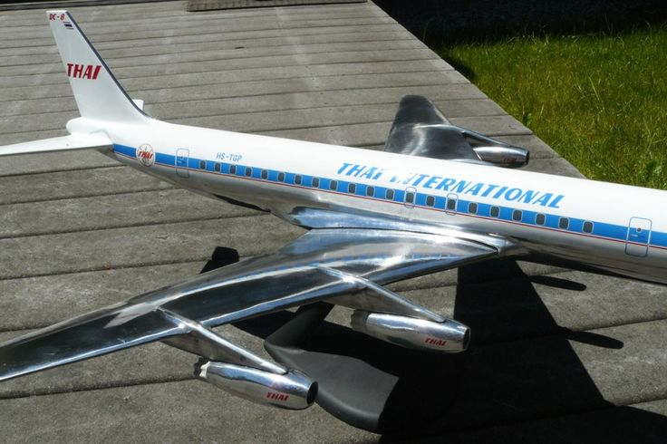 "We recently made this 1/50 metal DC-8 model for a customer. It represents Thai DC-8-33 HS-TGP. The model measures 36"" long and is made of cast aluminum."