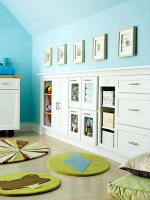 """Here's the perfect storage solution to the angled ceiling. Sometimes there is """"dead space"""" below and behind the wall of this type of ceiling - this space was utilized with storage cabinets, perfect in a child's room or playroom."""