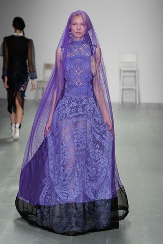 What I particularly love about this garment is the sheer material covering the models face. It suggests more of an hidden meaning behind the collection which relates strongly to the theme. The bright purple palette is striking and beautiful and sits amongst the variety of subtle colours with in the collection ranging from white to black.