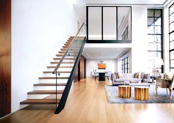 Modern New York City Apartment glass staircase railing light wood floor shag rug tree stump side table