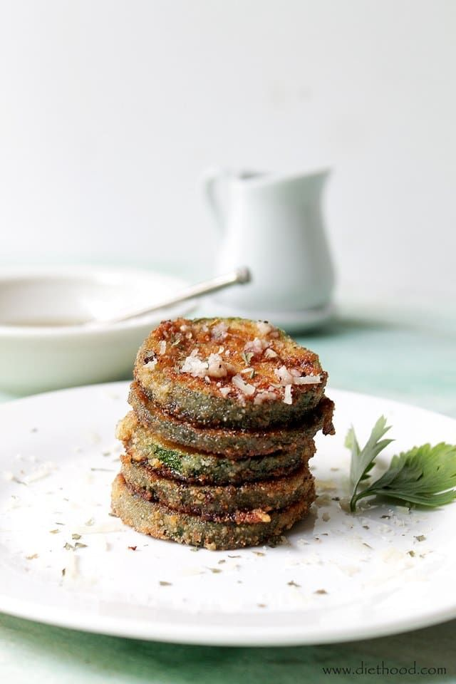 Fried Zucchini Chips with Garlic Vinaigrette: Zucchini rounds coated in breadcrumbs, fried to a crisp, and dressed with a drizzle of a garlic vinaigrette.