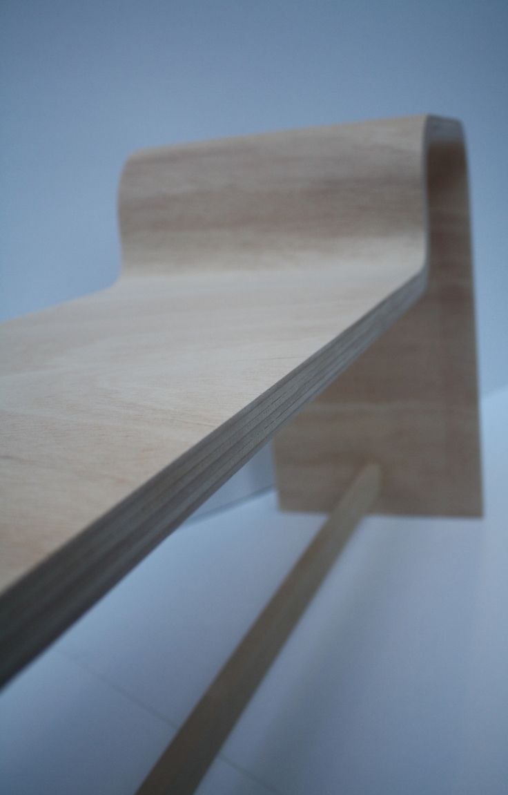 Wave.  Bended bench with sidetable