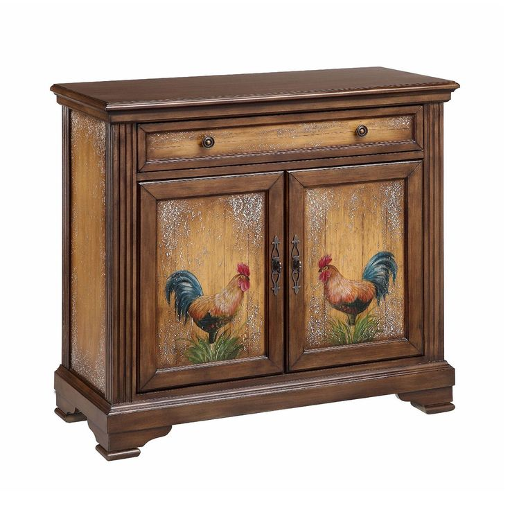 This Jolegh accent chest delivers beauty and functionality to your home. Hand-painted roosters adorn the doors that provide access to the storage space, and a wonderful weathered finish completes the charming look.