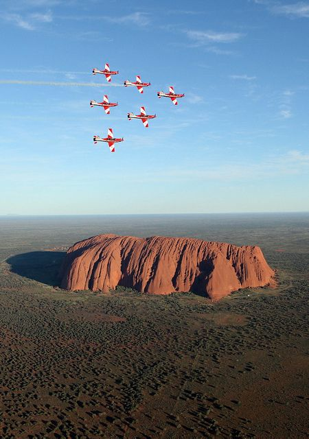 The Roulettes fly in wedge formation over Ayers Rock, Australia