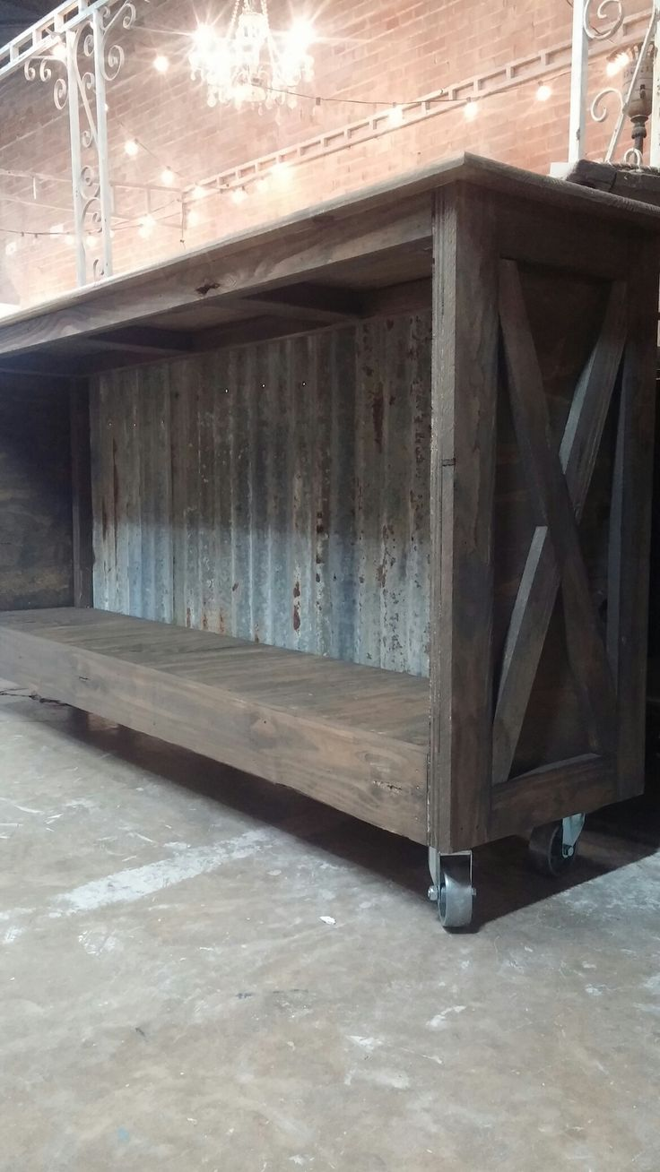 custom built console! reclaimed wood, corrugated tin & casters!