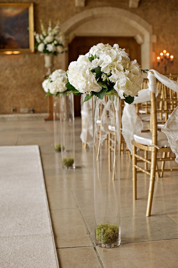 i like the idea of using center pieces as aisle decoration first