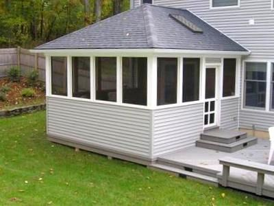 Screen Porch with Hip Roof adjoins Patio Deck, Project by Archadeck