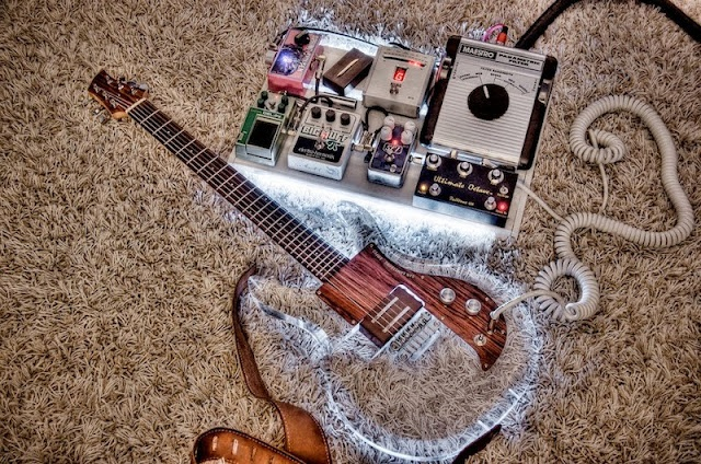 Cool pedal board, and really wicked wood/acrylic guitar!