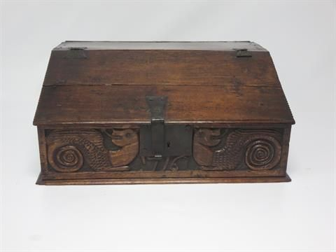 A 17th Century oak Bible Box with sloping lid, iron butterfly hinges, later dragon carved frieze having date 1716, 2ft 3in. Sale 15 Jan 2014 £310