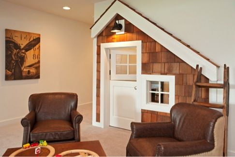 Shingled playhouse under stairs
