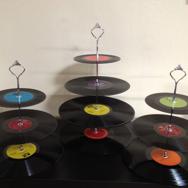 Vinyl cupcake stand complete, DIY instructions found at   http://www.bubbyandbean.com/2011/12/diy-tutorial-vintage-vinyl-record.html