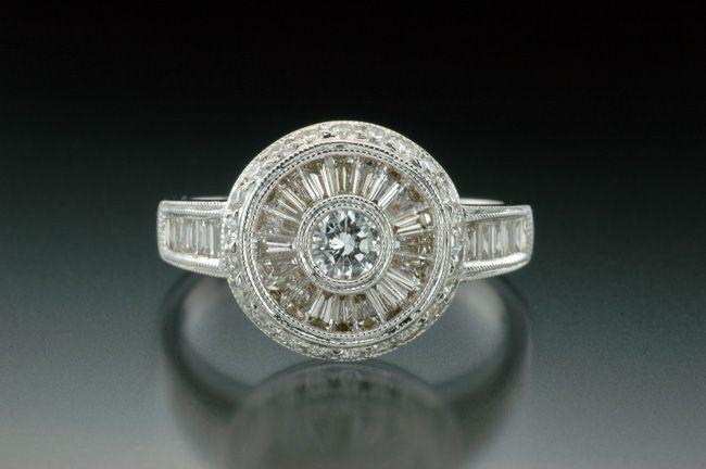 Michael Schofield bezel set halo engagement with baguette and roud diamonds