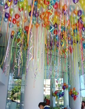 Colorful! Balloon and streamer décor.  I like it when it hangs from a normal ceiling height too.  Perfect for the little kids to take when they leave too!!!