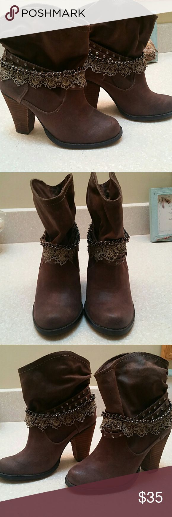 Not Rated Booties Not Rated booties in excellent condition, worn once. No stains, tears, etc. Low heel makes these very comfortable to wear and can be worn with jeans or shorts. Not Rated Shoes Ankle Boots & Booties