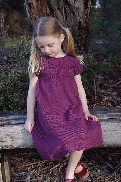 Caesia is an easy to knit and simple to wear garment inspired by outdoor play and Australian flora. Caesia can be knit as either a dress or tunic and features a gathered circular yoke and touches of gathering on generous pockets perfect for stuffing with treasures and wildflowers.