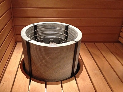 In this blog there is a Tulikivi soapstone sauna heater called Naava. The electric sauna heater is integrated to the panels. Elämäni huoneet: Lauteet