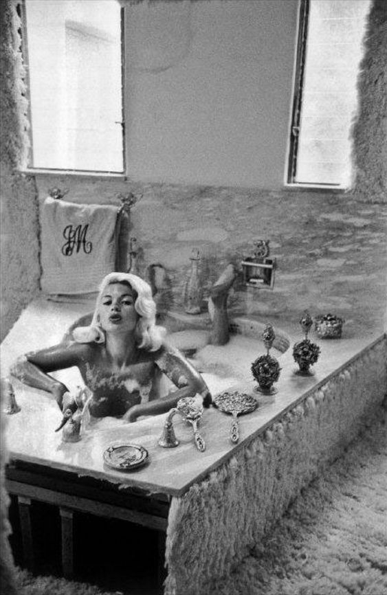Jayne Mansfield at home, Hollywood, 1959. giggle...notice the wall to wall on the wall carpet.
