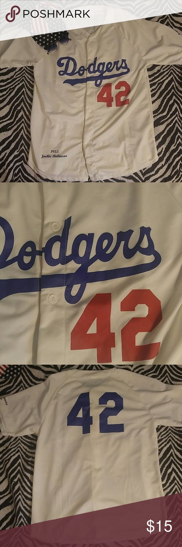 Los Angeles Jackie Robinson replica jersey XL Beautiful and flawless jersey commemorating one of the greatest heroes and icons in the history of sports. Lightweight jersey perfect for catching games all summer! I believe this was a Dodgers stadium promotional item making it a great collectible. Flawless, like new condition! Shirts