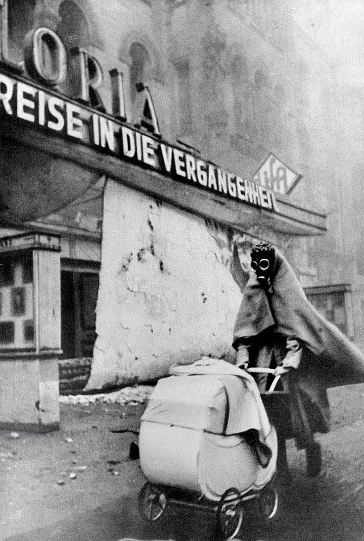 © Wolf Strache, Nov. 23, 1943, Berlin Kurfürstendamm --- Wolf Strache considered this iconic image taken during WWII one of his best photographs and it has become a symbol of that time. The original negative was confiscated shortly after its production and Strache made another negative in the 1970s with which he made later prints. The sign advertising the film Reise in die Vergangenheit (Trip to the Past) makes the image all the more poignant.