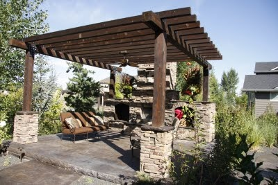 Pergola With Cultured Stone Bases And Patterned Stained