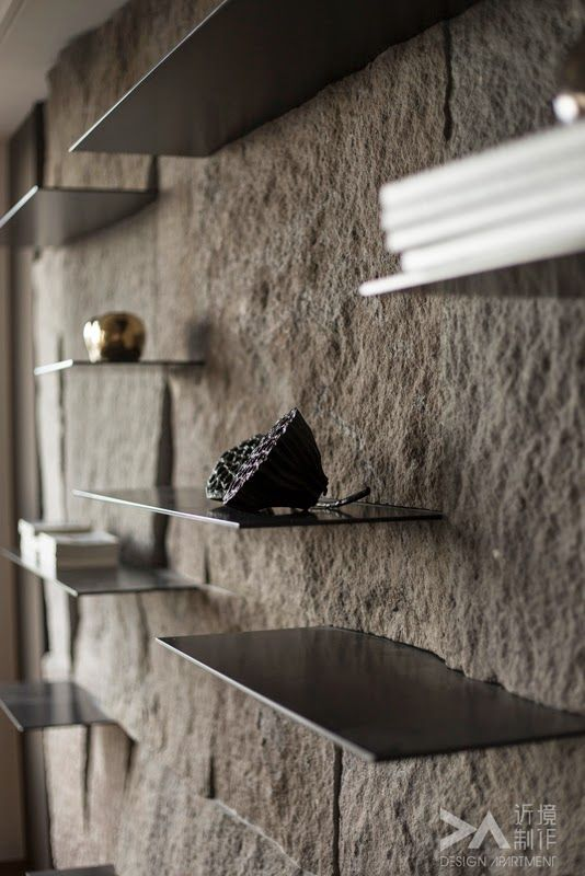 Steel shelves in stone wall
