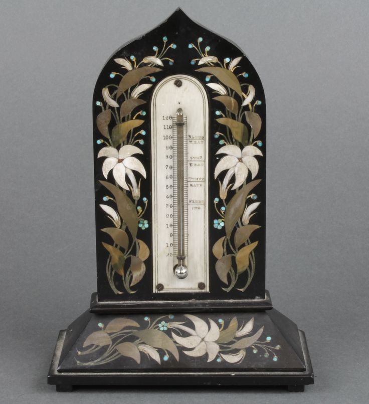 "Lot 793, A Victorian thermometer with ivory dial contained in an arch shaped pietra dura floral marble case 7 1/2"", est  £80-120"