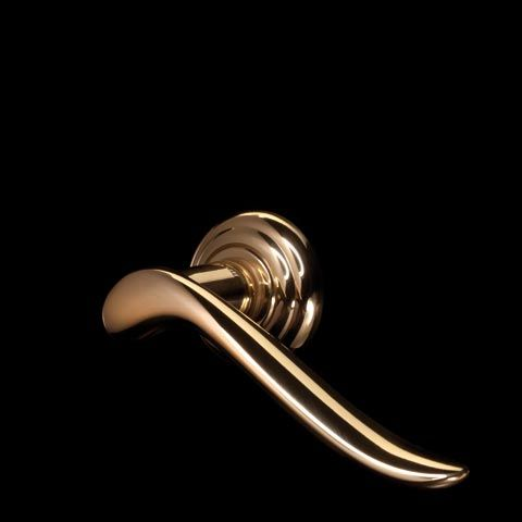 RONDO' series 640.  ALL MADE IN ITALY.  All Solid Brass.  Designed by CENTRO STILE MANDELLI.  Produced by Officine Mandelli1953 Maniglie - Door Handles / Levers.  Photo by Davide Bordogna.  Since 1953 our products are the highest expression of Italian craftmanship in the world of luxury house.