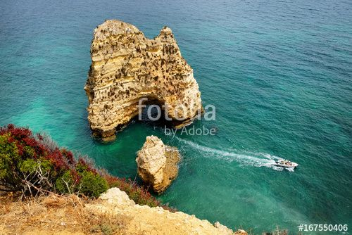 "Download the royalty-free photo ""Lagos coastline with cliffs in Atlantic ocean, Portugal "" created by stillforstyle at the lowest price on Fotolia.com. Browse our cheap image bank online to find the perfect stock photo for your marketing projects!"
