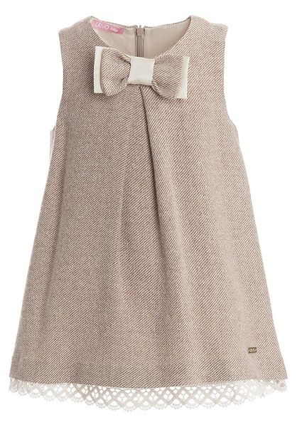 Beautiful baby girls pinafore dress by Liu-Jo with interwoven gold thread and a pretty double-layered bow on the front. It has a silk-soft lining with a pretty lace hem and a hidden zip fastening on the back. It is made from a lightweight wool mix and is perfect for wearing on its own or layering over tops. £ 68,00