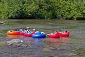 """""""Find Your Inner Tube"""" ... Zen Tubing - River Tubing in Asheville, NC ... floating without a care on scenic, slow-moving class I water on a 4-mile stretch of the French Broad River through the heart of Asheville, from near the Long Shoals bridge to near the old Sandy Bottom park."""