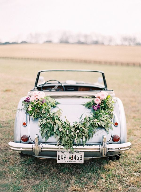 getaway car done right!  love the lush floral garland   wedding car vintage//