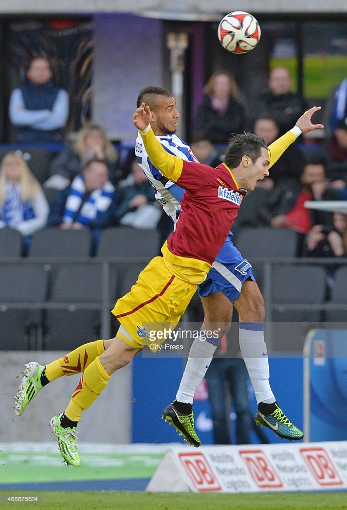 John Anthony Brooks of Hertha BSC heads the ball against Srdjan Lakic of SC Paderborn 07 during the game between Hertha BSC and SC Paderborn 07 on april 5, 2015 in Berlin, Germany.