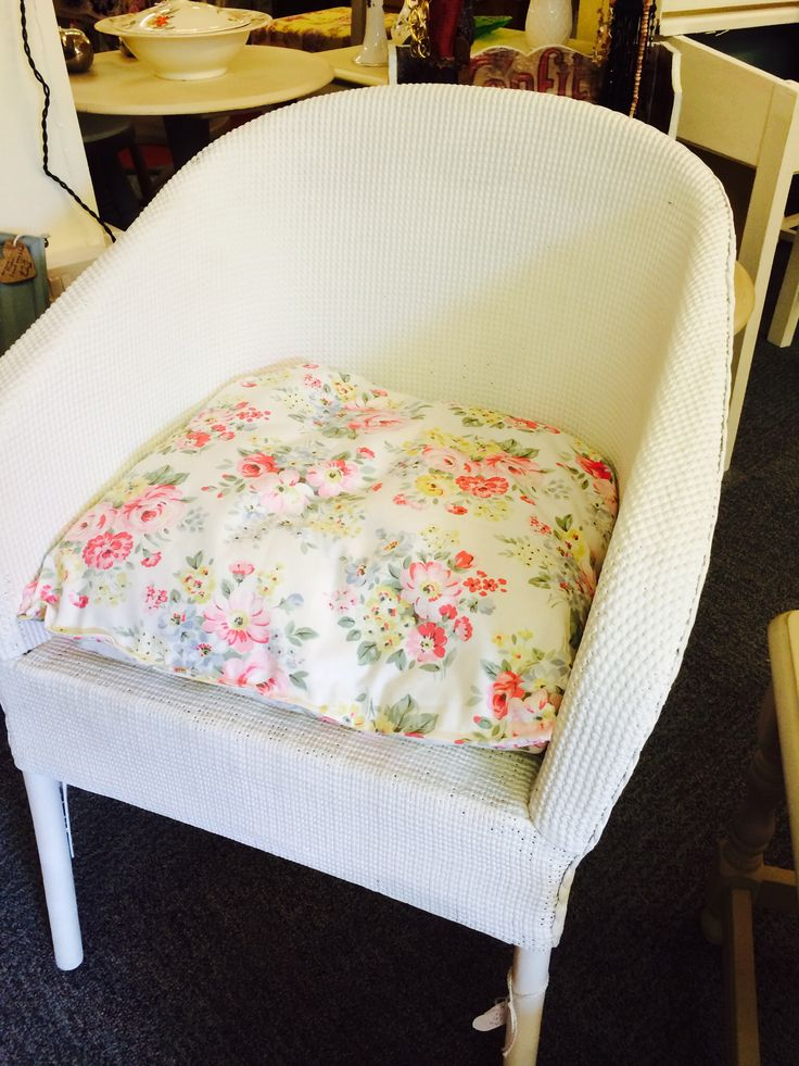 Lloyd loom style wicker tub chair painted in Annie Sloan Chalk Paint Old White, with a Cath Kidston fabric cushion.