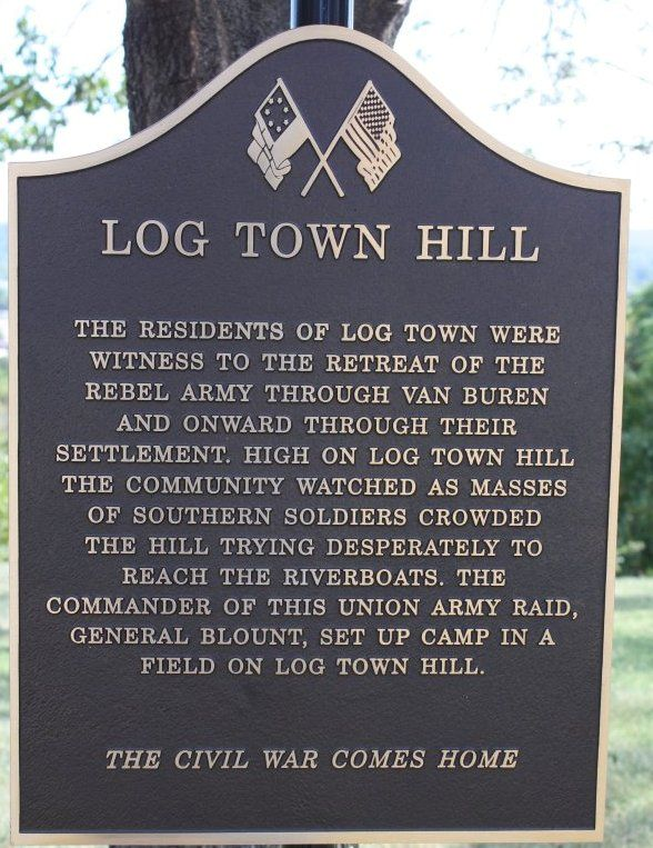 This plaque is at the top of Log Town Hill in Van Buren, Arkansas. It's on 59 highway, and the part of the road that starts down the hill into Van Buren's Main Street is called Log Town Hill. I've driven down that hill so many times. It's really on the side of a cliff with the Arkansas river below the cliff. Part of our town's history.